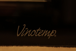 Vinotemp logo on glass fridge door